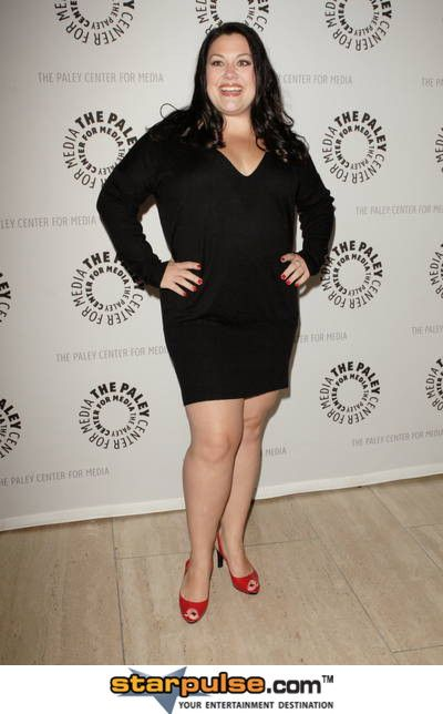 Brooke Elliott shows us the little black dress that will flatter a woman with a tummy.