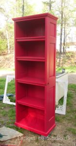 How to Build a Bookcase Using an Old Door - Love the shape, love the color, love the use of old doors! ~