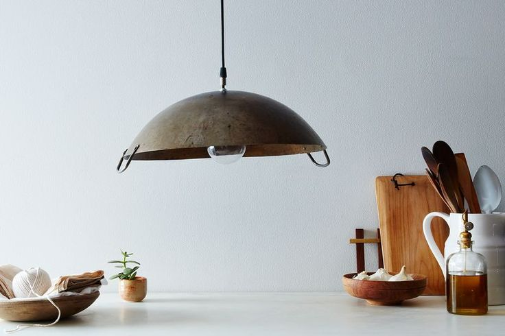 Once a wok, now a pendant lamp.