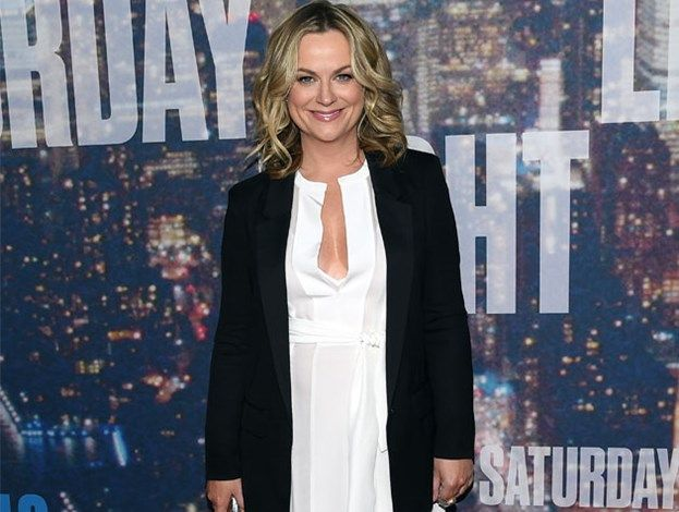 Saturday Night Live 40th anniversary - SNL alumna Amy Poehler dazzles in white as she arrives at the show.