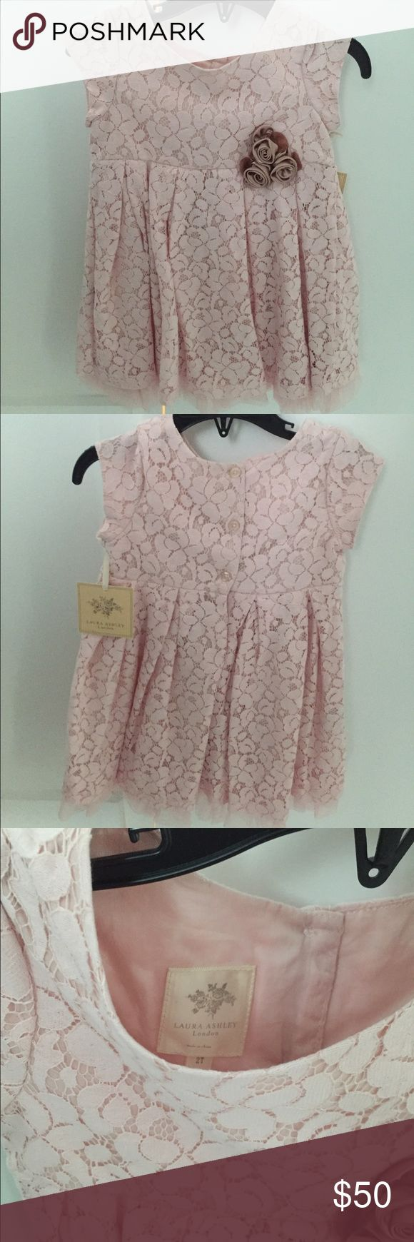 Girls pink lace Laura Ashley dress Beautiful pink lace girls fancy dress by Laura Ashley. Full lined with second layer tulle trim on the end. Rose detail attached. New with tags. Size 2T. Laura Ashley Dresses Formal