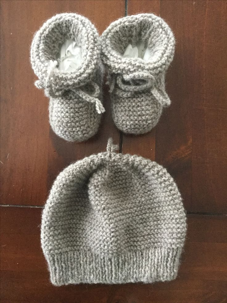 Garter stitch matching baby bootees and beanie. Hand knitted in light coloured natural 4 ply  New Zealand merino wool.  Size 3 to 6 months.