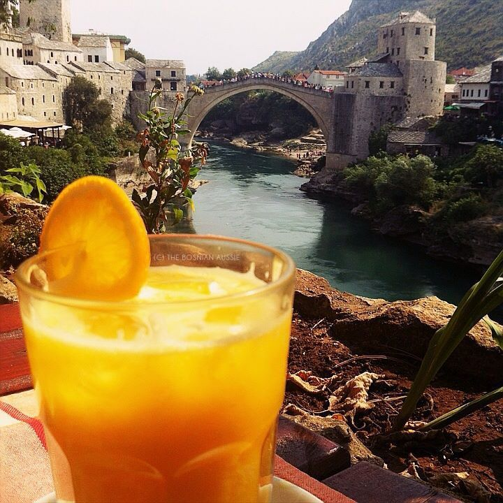 Enjoying my fresh orange juice on a hot summers day with the most gorgeous view of Mostar - August 2013