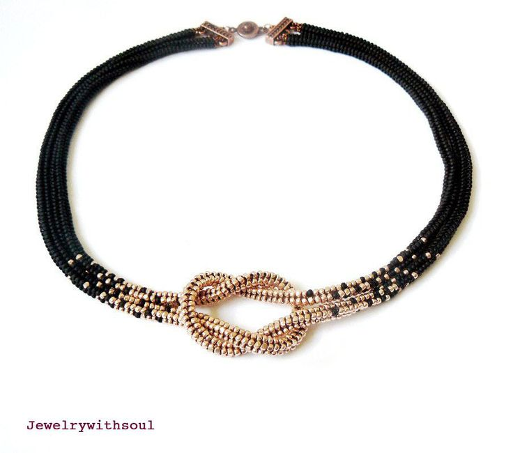 Reserved for Sandy- Infinity beadwoven love knot choker seed bead necklace in matte black and shiny metallic rose gold. $45.00, via Etsy.