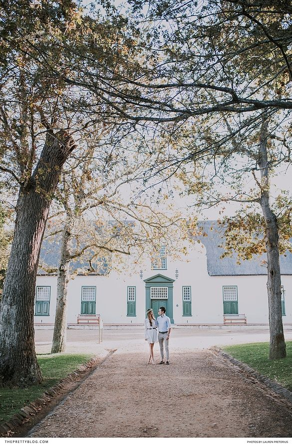 Groot Constantia South Africa engagement shoot with light blue and white tones and the beautiful outdoors! http://tpb.staging.wpengine.com/wedding/heating-up-winter-with-their-engagement-at-groot-constantia/?utm_campaign=coschedule&utm_source=pinterest&utm_medium=The%20Pretty%20Blog&utm_content=Heating%20Up%20Winter%20with%20Their%20Engagement%20at%20Groot%20Constantia