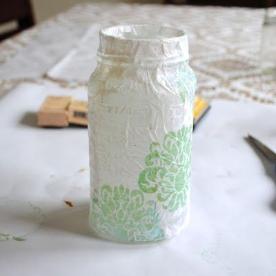 """DIY Lanterns Materials: • Mason  jar • Tissue paper {new or recycled} • Mod Podge • Ribbon • Scissors and paintbrush • Stamp pads and stamps {optional} Step 1: Cut tissue paper to size to wrap around jar. Step 2: Use brush, cover jar with thin layer of Mod Podge & wrap  pre-cut paper around jar. Step 3: Keep brush full of Mod Podge and begin """"painting""""  glue on while adhering paper - be sure the paper is completely damp while wrapping.  Step 4: Let jar dry completely. Step 5: Repeat."""