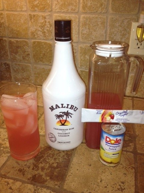 I call this the Frisky Native: Take one packet crystal light strawberry/orange/banana and pour it into a two quart container.  add one small can of pineapple juice.  fill the container to the two quart mark (with water) and stir.  now, for the really good part ... fill your favorite glass with ice.  pour in two ounces (or more) of coconut rum.  then fill to the top of glass , add fresh pineapple and enjoy.