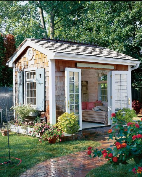 The Quaint Escape:  With a cozy daybed and French doors that swing open to a charming and lush garden, this she-shed is the ultimate spot for whiling away a summer afternoon.