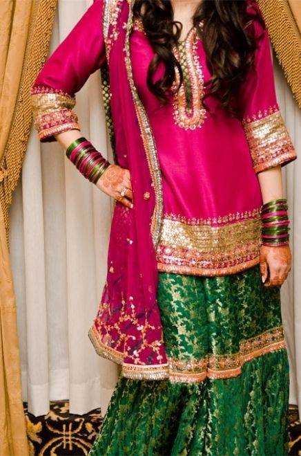 Pink short kameez with zari work paired with Green and Gold Gharara