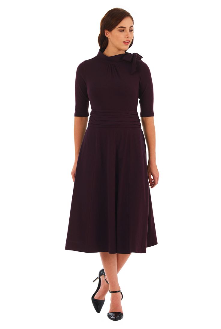 Our cotton jersey knit dress gives you a flattering look in a fit-and-flare cut with soft ruching nipping in the wide waist and sweet ties at the high neck.