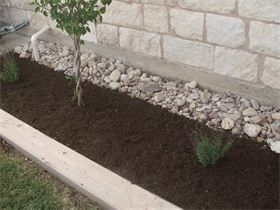 Juans Landscaping - Rock and Mulch Flower Bed Design