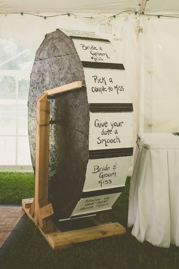 How awesome is this wheel they created for their wedding reception? Even if you didn't have a giant wheel laying around, this would be a simple idea to recreate with the spinner from your Twister game or the lazy susan from your kitchen!
