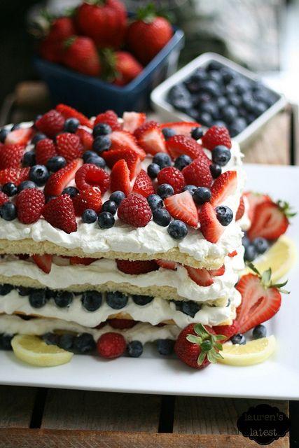 Triple Berry Layered Lemon Cream Cake - A pretty dessert recipe for the 4th of July.