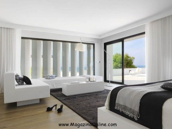 susanna cots completed the design of the pure white house a modern residence located in almuecar granada with extensive sea