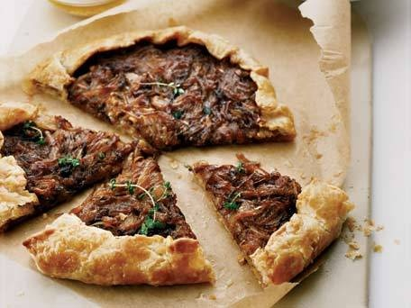 Free-Form Onion Tart recipe - This savory onion tart is delicious paired with a salad for lunch or served as an appetizer. Cook the onions slowly for at least 20 minutes to get them caramelized. And use a pizza stone in the oven to get it really crisp