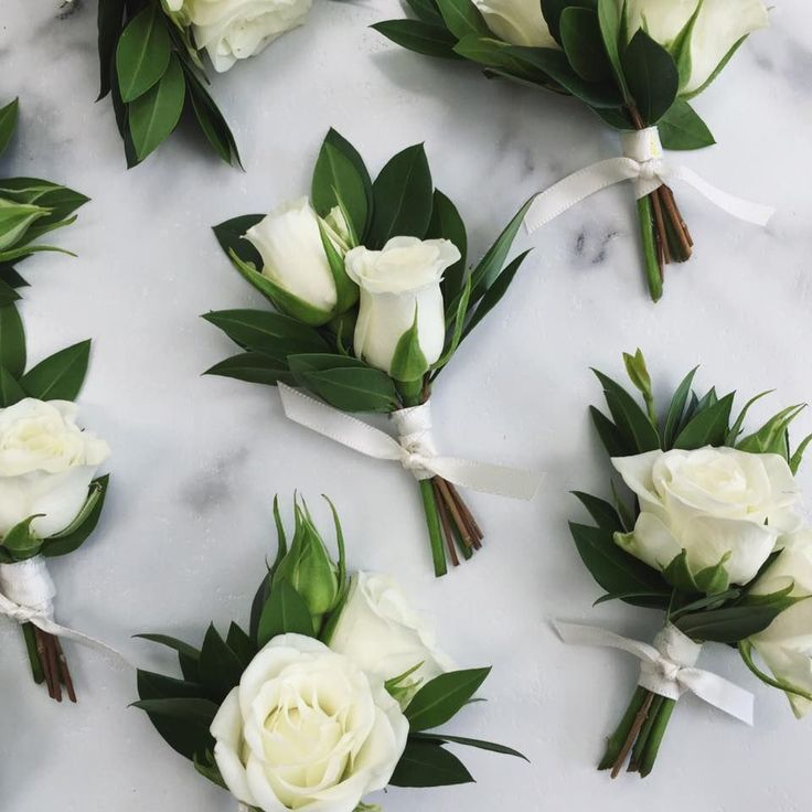 White Spray Rose Boutonnieres with greenery