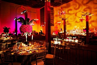 Moulin Rouge but still elegant centerpieces and table set up