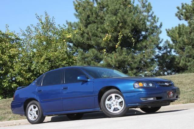 2005 Chevrolet Impala LS.  Mine's black and a 2004.  3.8L V6.