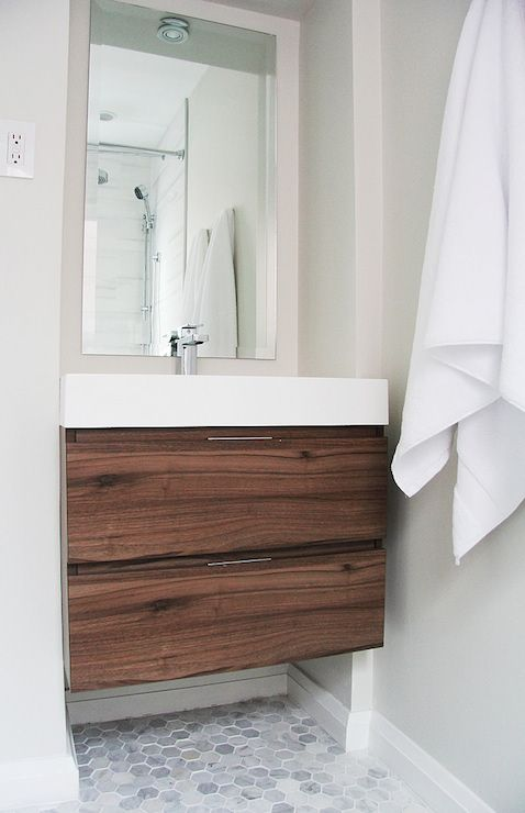"Fabulous bathroom with modern floating vanity, Veneto Bath 690C in Walnut, with white countertop filling alcove over 2"" hexagon marble tiled floor."
