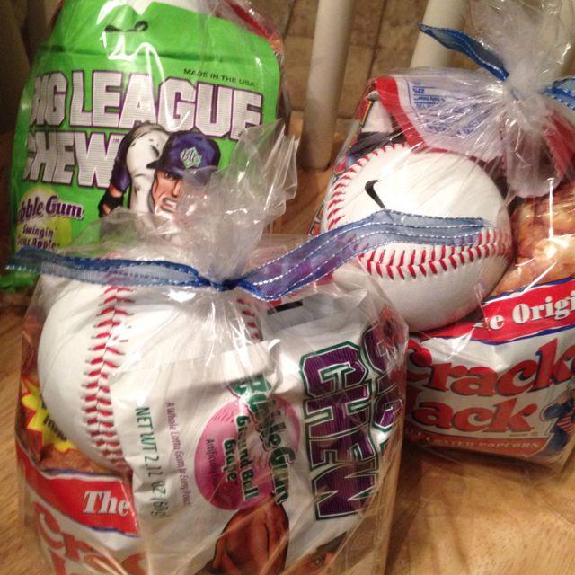 Baseball treat bags....sunflower seeds, cracker jacks, big chew gum, baseball, and a Gatorade. Great gift for a little boy.