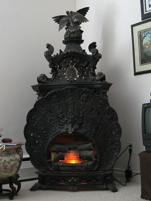 Antique Cast Iron Friedre Siemens Wien Parlor Stove with Ravens Fishes