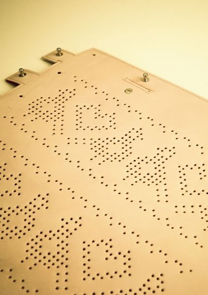 Perforated loveliness - Pixelfolk 2011 bag from TheBetaVersion