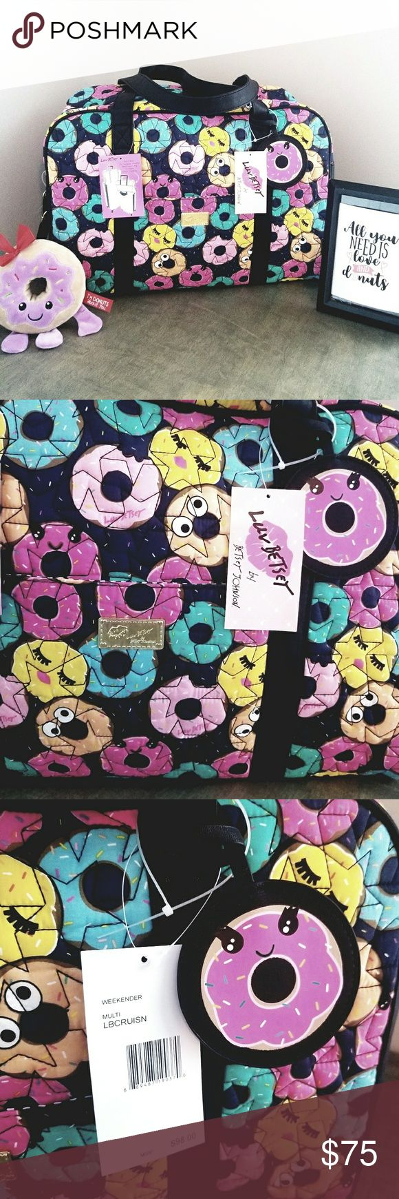 """New Betsey Johnson Weekender **DONUTS** Betsey Johnson weekender overnight luggage travel bag. This Donut Cruisin Duffle Bag features a quilted material with aches star pattern and blue, orange, pink, and yellow colors, doughnut designs, black faux leather, two carrying handles, one removable shoulder strap, and top zip closure. Emoji kiss eyelashes Interior: one zip pocket, one open pocket, and three pen slots 100% Cotton Imported 19"""" x 7"""" x 13.5"""" Exterior: one open pockets Betsey Johnson…"""