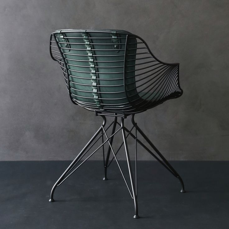 Overgaard & Dyrman, Wire Dining Chair. Shows the leather details on the back of the furniture - www.oandd.dk