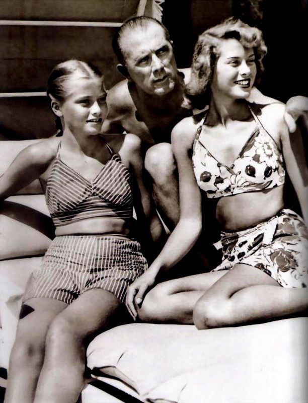 Young Grace Kelly with her dad and sister, Lizzie.
