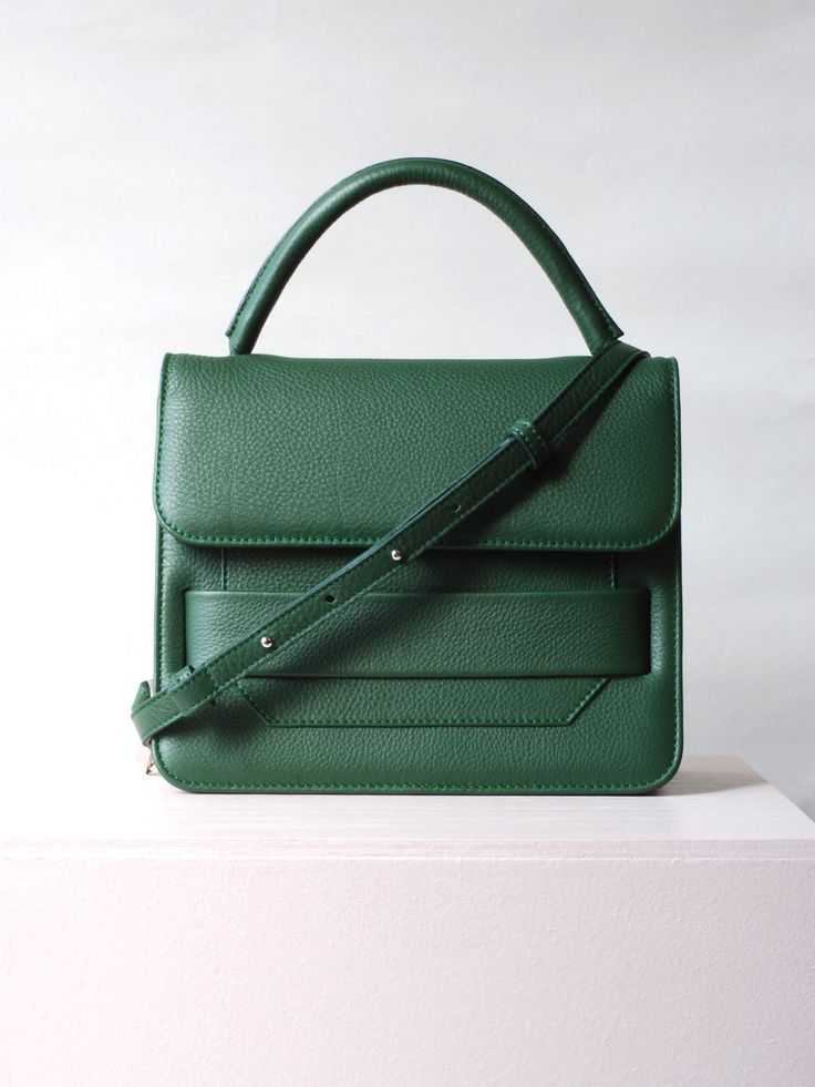 """Jump Green by a.nordin With room for all your daily essentials, this small bag will be your best friend in no time!The leather is soft, lightly textured with a matte finish for a classic and versatile look that will go with almost any outfit. The leather we have chosen for the bags is the Swedish """"Elmo"""" leather, usually used for furnitures. This is because we know it is durable and will look good for a long time, it's a win-win!Check out this video if you are interested in knowing more about…"""