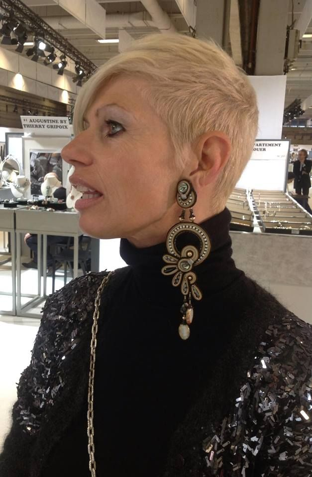 Luisa of Dalaleo (https://www.facebook.com/Dalaleo.Ecobags?fref=ts) came by our booth at the Premiere Classe, Paris show and couldn't resist our Wings earrings… #jewelry #doricsengeri