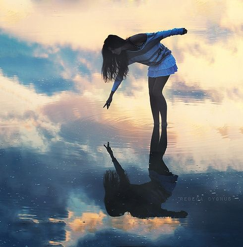 Reflect....  Riding the clouds? or in troubled waters she stands?  Reaching for the sky? or reaching out to self?  Trying to hold still, for ripples make the dream disappear,  Tracing patterns in the air, so colours don't disappear ~ Poonam.