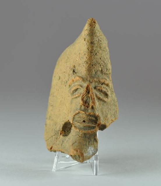 Phoenician mask, 6th-3rd century B.C. Phoenician pottery miniature mask of a deity, 7.5 cm high. Private collection