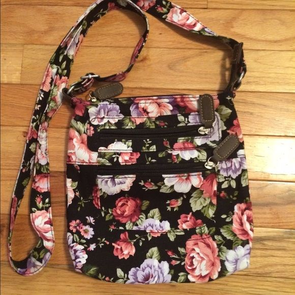 Cross body bag Like new beautiful Cross body bag with flowers 3 zippered compartments no tears or stains. Strap is adjustable. Bags Crossbody Bags