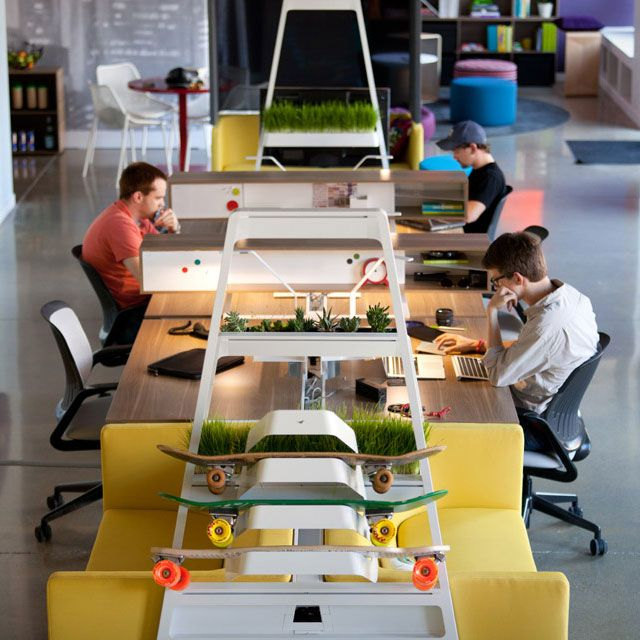 cool office with cozy benches instead of side chairs