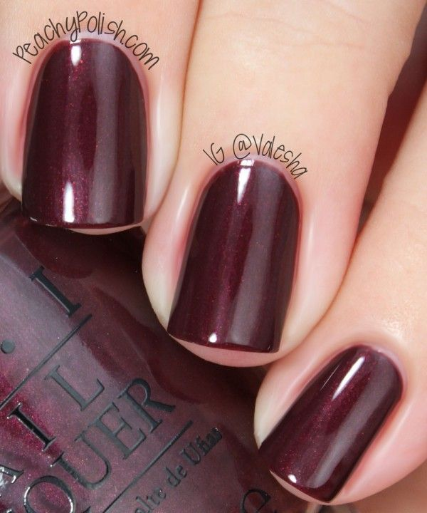 """Sleigh Ride For Two"" is a dark chocolate polish with a strong red shimmer."