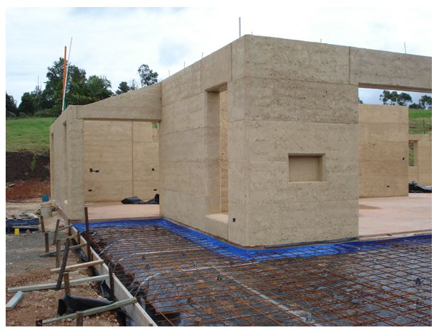 Rammed earth construction, rebar foundation setup...  http://www.rammedearthnational.com.au