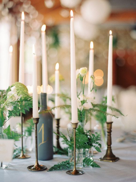 taper candles and ferns | Ryan Ray Photo - like the idea of having 2-3 tall thin candles on the table rather than a big chunky candleabra..