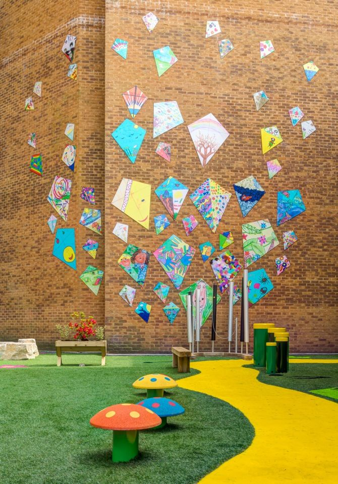 Kite Design Mural completed at Hafan-y-Môr, the new Children's Development Centre at Singleton Hospital, Swansea. 55 kite designs done by young people from across the Swansea | ART ACROSS THE CITY