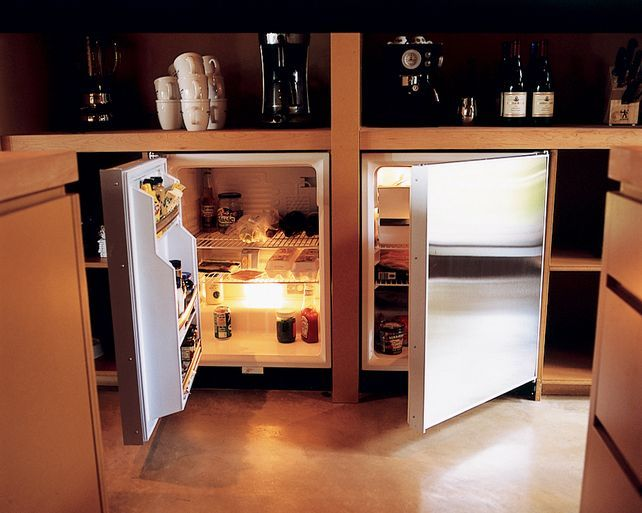 Great idea - keep full-size fridge in basement, use two smaller under the counter units in kitchen.  Loooove.