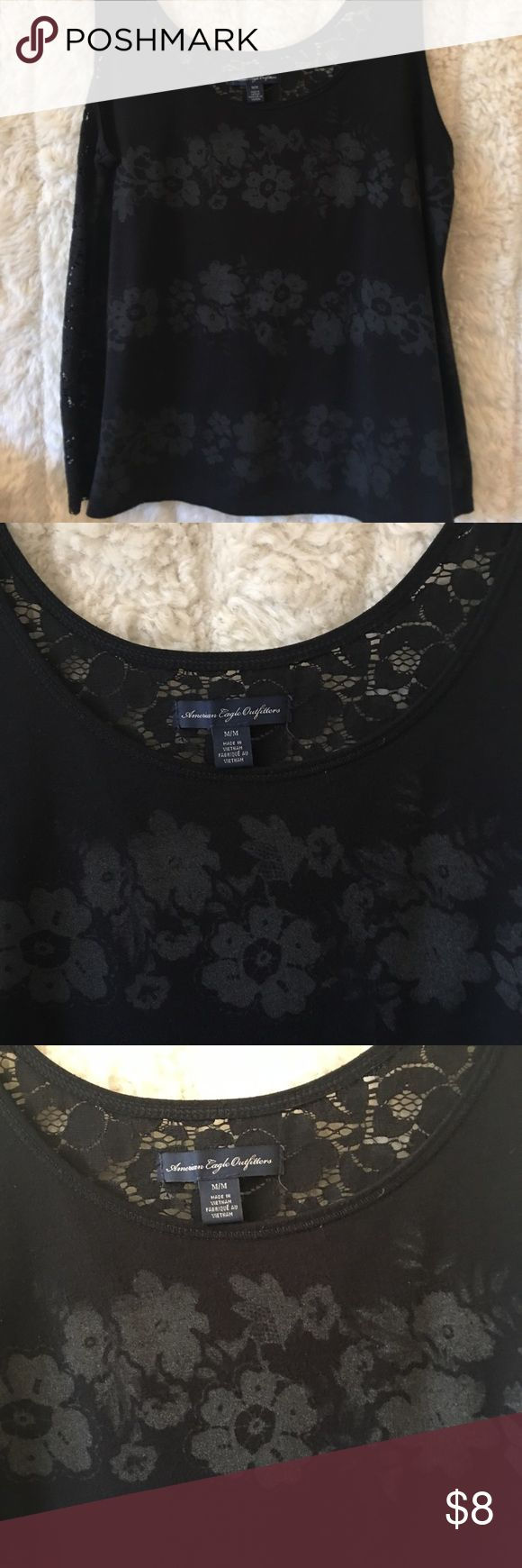 """American Eagle Outfitters Tshirt Tank Size Medium American Eagle Outfitters black lace back Tank size medium. Measures 17"""" arm pit to arm pit , 23"""" shoulder to hem, 20 1/2"""" across the bottom. American Eagle Outfitters Tops Tank Tops"""