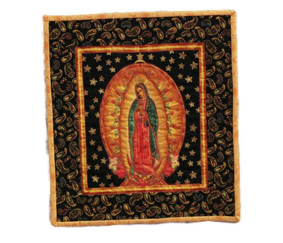Virgin de Guadalupe quilt - Hang it on a wall and see all the compliments you will receive. This is an art quilt made to stand out and be noticed. A perfect addition for any Guadalupe/Mexican art collector. Random colors have been used to thread paint the details of this fabrics pattern. Quilt shop fabrics/Mettler threads.  Out of print fabrics**  Dimensions- 15 1/2 x 14 = inches 39.37 x 35.56 = cm  ♥ Expedited shipping with tracking #  ¨¨¨°º©©º°¨¨¨¨¨¨°º©©º°¨¨¨¨¨¨¨°º©...