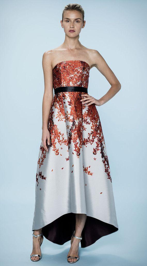 SACHIN&BABI Akahana Gown Strapless midi dress with slight high-low hem. Grosgrain belt accentuates the waist. Red autumn print on Italian jacquard.