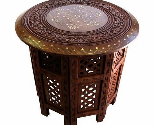 CE Hand Made Items Indian Hand Carved 15`` Table with Brass Inlay 15 Hand Carved Indian Round Table<br/><br/>Made from Rosewood with Brass Inlay<br/>Hand Carved by master carvers in India<br/>Octagonal Shaped B (Barcode EAN = 5055432518734) http://www.comparestoreprices.co.uk/indian-furniture/ce-hand-made-items-indian-hand-carved-15-table-with-brass-inlay.asp