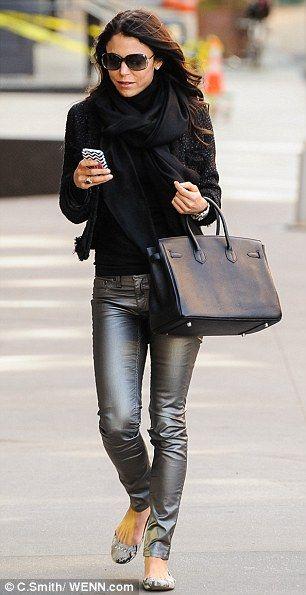 Bethenny Frankel shows off her slender legs in silver jeans