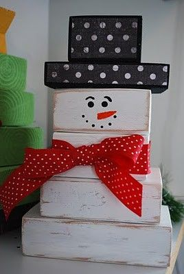 Snowman~ made out of 2 X 4 wood. Cute winter craft! Could use old wooden blocks of graduated sizes for a school craft.