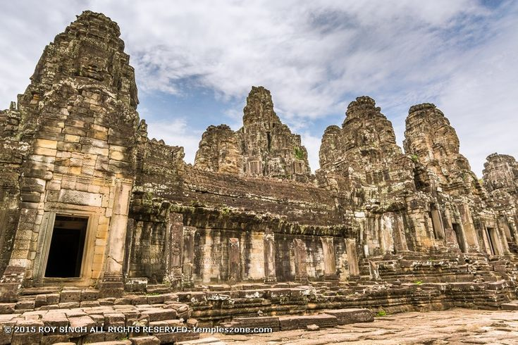 Angkor Thom city (two miles north of Angkor Wat) is moated walled city that covers nearly four square miles and is laid out in a square and for centuries it was the seat of the Khmer government.