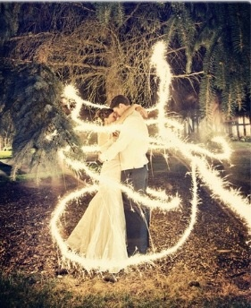 Just take a log exposure shot and stand really still and have someone run around you with a sparkler - love it!!