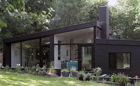Black brick house in the woods outside London by Takero Shimazaki and Charlie Luxton