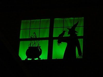 Halloween Window Silhouettes--these are painted on white sheets--but vinyl could be used and the sheets rolled up and kept for each year!                                                                                                                                                                                 More